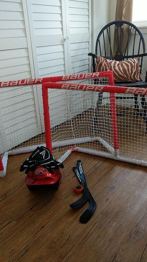 Knee hockey two sticks...Baseball helmet and baseball gloves for Sale in Wildwood, NJ