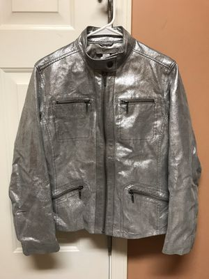 Beautiful 100% Leather Coat, Color Silver, all Zippers work Freely, Excellent Condition, no stains anywhere, looks new still. Chico's Size One which for Sale in Clayton, NC