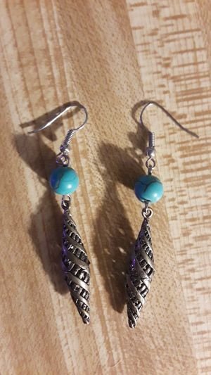Turquoise earrings with cone shaped cage detail for Sale in Los Angeles, CA