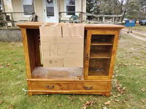 A free entertainment center Hardwood for Sale in Millville, NJ
