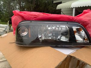 When mustang headlights still in the box never usedThey will fit an 87 through 93 for Sale in Spring Hill, FL