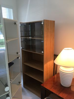 Display cases with glass doors bookshelves for Sale in Boynton Beach, FL
