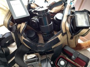 Canon A1 with all you see on picture camera/motor drive/50mm lens/135 mm lens/300 mm lens/ fish eye / filter/flash wi for Sale in Virginia Beach, VA