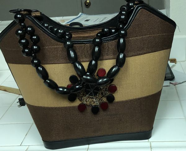 Ladies hand bags made with authentic African materials. Different colors available