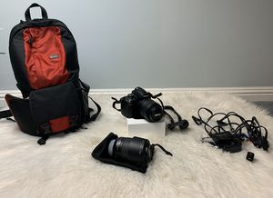Nikon D3000 Camera + 2 lenses, camera backpack and tv cords for Sale in San Diego, CA