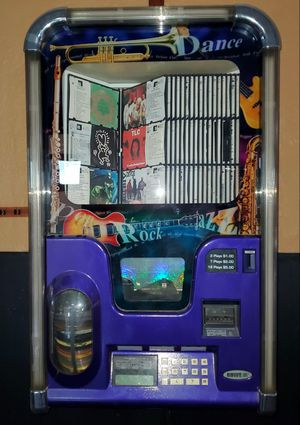 Ami Rowe Wall Mount Jukebox filled with CDs in Comes with wall bracket. Set to Free play or money. for Sale in East Providence, RI
