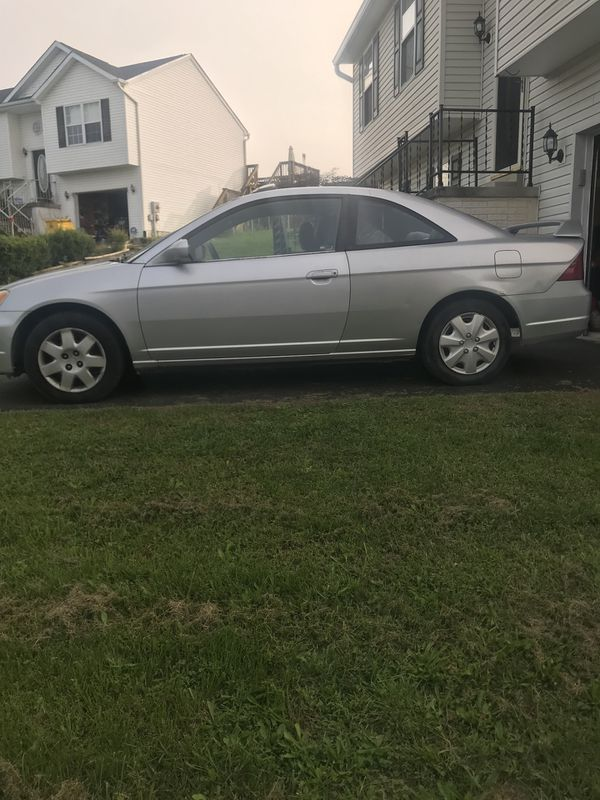 2001 Honda Civic EX 2 Door Coupe With Sunroof ! 210,000 miles ! Ac runs cold , tires in good shape, but car does overheat sometimes. Easy fix for Hon