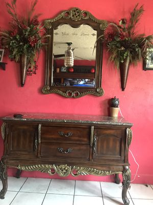 Credenza table or sofa table mirror and flower scones for Sale in Tulsa, OK