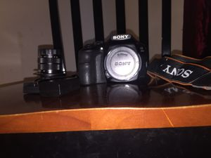 Sony a3000 with extra battery. With vintage lens and mount Charger and a Sony strap for Sale in Oak Hill, VA