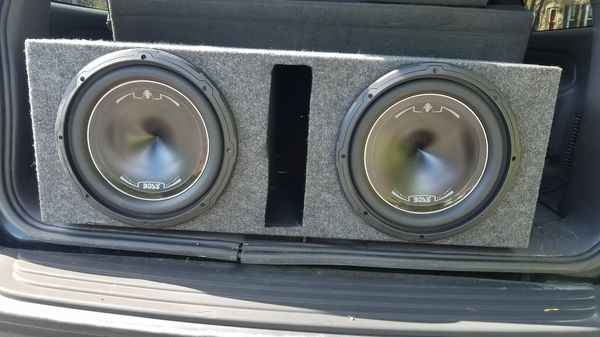 Dual 12 inch subwoofers in encasing with amplifier