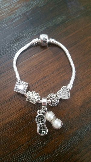 Bracelet with silver charms for Sale in Lombard, IL