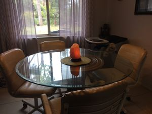 Thick glass Kitchen Table with 4 comfy rolling chairs for Sale in Sebastian, FL