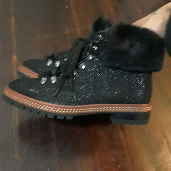 A pair of Kate Spade boots Size 8