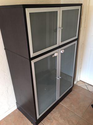 NICE IKEA SHELF BLACK WITH DOORS VERY HEAVY AND WELL BUILT for Sale in Phoenix, AZ