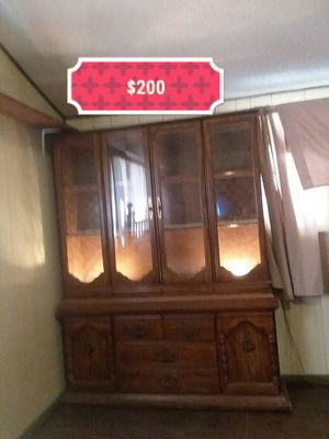 1970's china cabinet, 4 and half ft across, 6 and half ft tall, and 1 ft wide, inside light still works, top half comes off to transport it for Sale in Abilene, TX