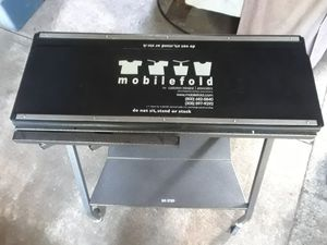 Mobilefold portable garmet folding table for Sale in Petaluma, CA
