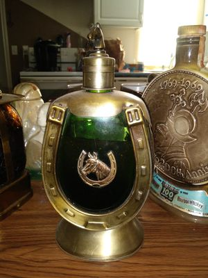 Antique horse shoe liquor bottle with scotch for Sale in Portland, OR