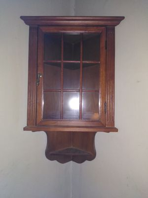 Nice wooden corner wall hung curio cabinet for Sale in Elizabeth, PA