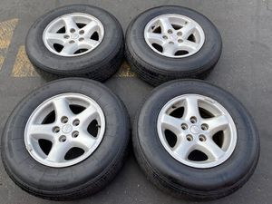 """(4) 15"""" Jeep Wheels + 215/75R15 tires - $325 for Sale in Santa Ana, CA"""