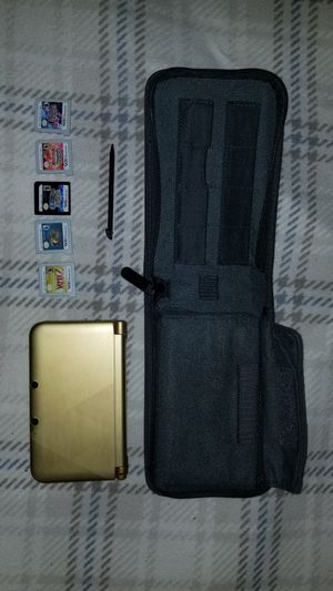 Nintendo 3DS XL with case and 5 games for Sale in Boston, MA