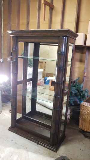 Bamboo cabinet with glass shelves and a decor light for Sale in Orland, CA