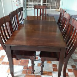 Beautiful Dark wooden dining room table with 7 chairs sets EXELLENT CONDITION AND LIKE NEW 🌹 SOLID WOOD Table have 2 leaves Each leaf 15 inches for Sale in Houston,  TX