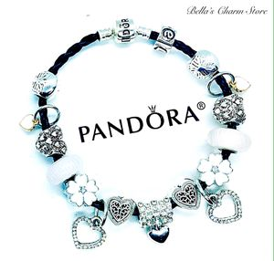Pandora Black Leather Bracelet With Beautiful Silver and White Charms for Sale in Marysville, WA