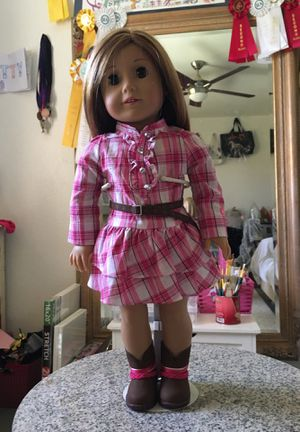 American girl doll comes with stand brand new no marks just has been sitting around outfit is in perfect condition hair soft for Sale in Phoenix, AZ