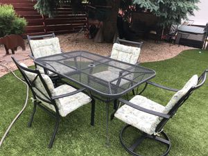 Wrought iron patio table with 4 chairs for Sale in Colorado Springs, CO