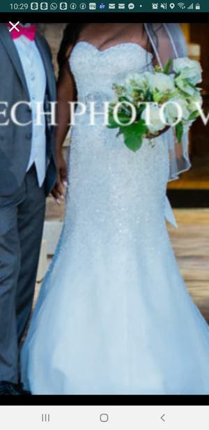 Nice wedding dress size 10 from David bridal for Sale in Pompano Beach, FL