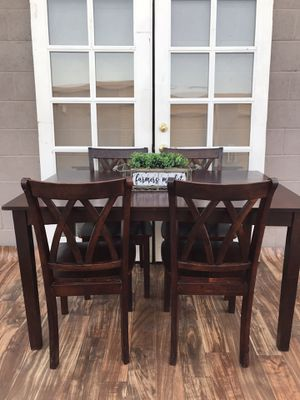 Heavy solid wood dining room table and 4 chairs l will deliver for an small fee for Sale in Woodbridge, CA