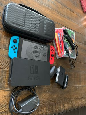 Nintendo switch console with case , 5 games luigi's mansion, Zelda, super smash bros ultimate, mortal combat, street fighter anniversary for Sale in Victorville, CA