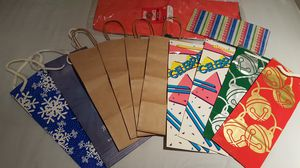 All 10 Christmas gift bags with gift tissue paper for bottles for Sale in Long Beach, CA