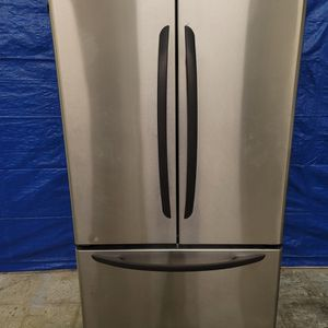 Kenmore Stainless Steel Fridge Good Working Conditions For $299 Missing Bottom Basket But Fridge And Freezer Working Good for Sale in Lakewood, CO