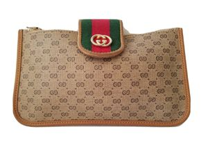 AUTHENTIC GUCCI GG MICRO MONOGRAM WEB BROWN/TAN PVC LEATHER VINTAGE POUCH/BAG for Sale in Henderson, NV
