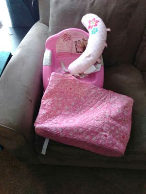 Girls pink diaper bag, head rest, booster seat for Sale in Austin, TX