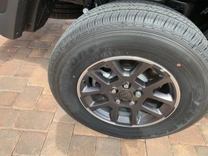 Bridgestone Dueler 255/70/R18 tires with wheels for a Jeep / set of 4 for Sale in Clermont, FL