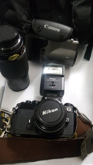 Nikon and canon photura camera for Sale in Houston, TX