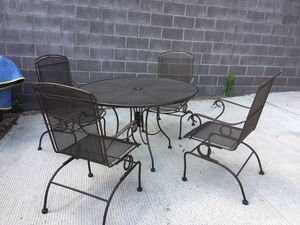 Brown. Patio set for sale. Metal table. With 4 rocket chairs like new we bought this last summer for Sale in Washington, DC