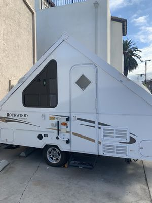 Forrest river rock wood hard side popup camper for Sale in Huntington Beach, CA