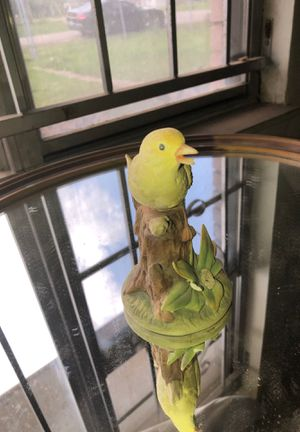Collectible antique yellow bird statue for Sale in Houston, TX