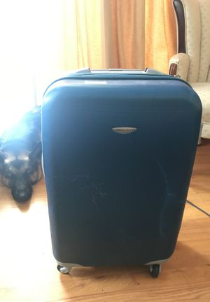 Blue hard shell suitcase for Sale in Rockville, MD