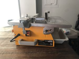 "Workforce 7"" tile wet saw, used once, manual and adjustment tools included!! for Sale in Frederick, MD"