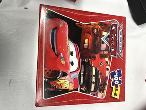 NEW Disney Pixar World Of CARS PUZZLE for Sale in Chicago, IL
