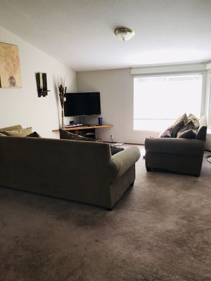 Large beige sectional couch for Sale in Bend, OR