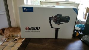 FEIYUTECH A2000 3 axis Aniversary Edition GIMBAL DUAL GRIP HANDLE DSLR CAMERA NEW NEVER USED for Sale in Miami Beach, FL