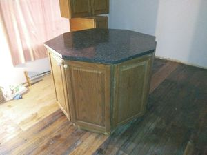 Kitchen island and cabinets 46 in across 3ft height it's actually Four wedge-shaped sections that form the island. for Sale in Gary, IN