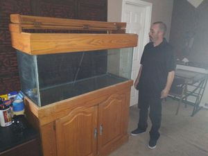 100 gallon fish tank and full salt water system cabinet with lights. Coral rock as well. for Sale in Las Vegas, NV