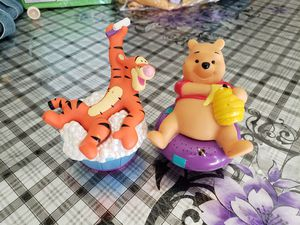 Winni the pooh and tigger water hose sprinkler for Sale in Riverside, CA