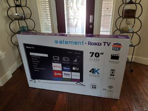 70 inch 4k uhd led smart tv with Roku ...new in box and sealed for Sale in Plano, TX